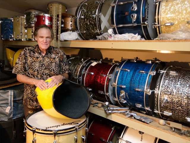 This photo taken Oct. 3 shows James Glay poses with his collection of vintage drums in Arlington Heights, Ill. Every passing month and unanswered resume dimmed Glay's optimism more. His career in sales was ended by a layoff. So with no job in sight, he joined a growing number of older people and created his own.