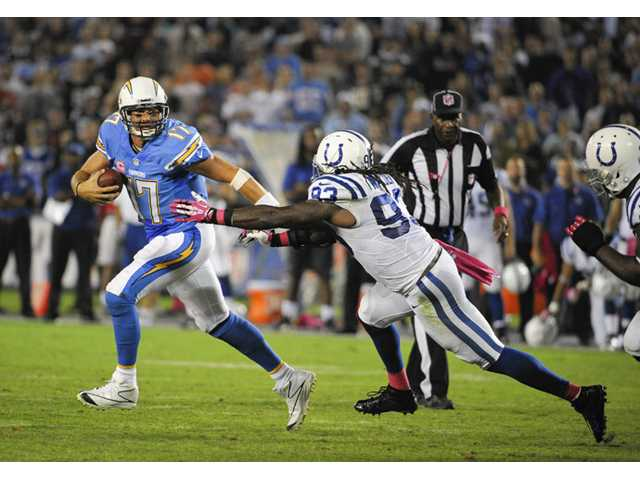 San Diego Chargers quarterback Philip Rivers (17) scrambles as Indianapolis Colts outside linebacker Erik Walden pursues during the second half.
