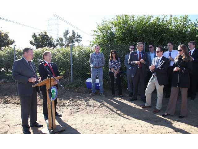 From left, Mayor Bob Kellar and City Councilman TimBen Boydston address community members during a groundbreaking ceremony today at Golden Valley Road and Centre Pointe Parkway. Photo courtesy of city of Santa Clarita