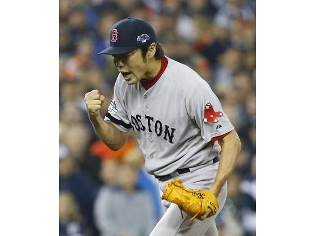 Boston Red Sox's Koji Uehara celebrates after the Red Sox defeated the Detroit Tigers 1-0 on Tuesday in Detroit.