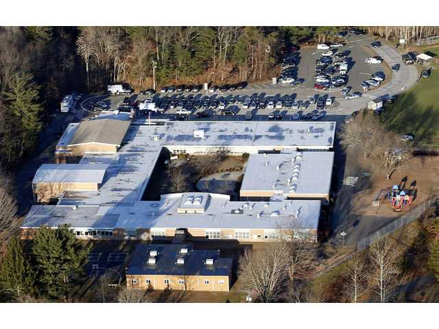 This Dec. 14, 2012 aerial file photo shows Sandy Hook Elementary School in Newtown, Conn.