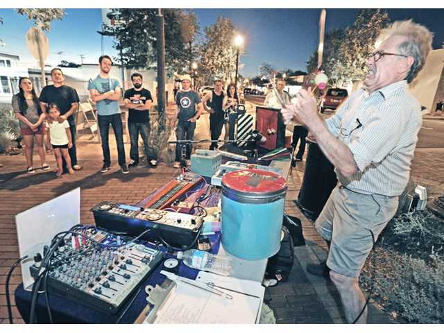 A crowd looks on as Tony Palermo, right, of Sparx Sound Effects, uses household utensils to demonstrates how sound effects are made for the movies in Old Town Newhall during the Sound Slam events last month.