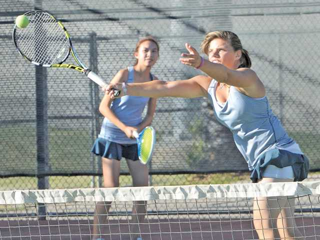 West Ranch doubles team Allison Vartany, left, and Jenny Cranert compete at Canyon High on Tuesday.