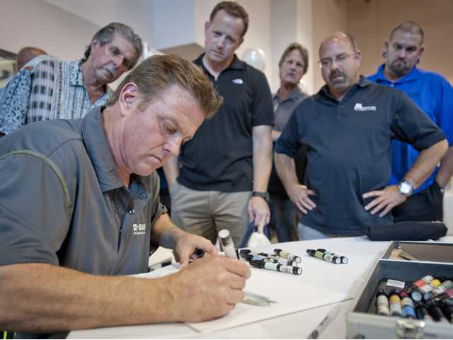 "Chip Foose, guest judge on the Discovery Challen's ""Ultimate Car Build-off,"" draws a sketch of a 1954 Corvette before a crowd of spectators during the Centre Pointe Collision Center fundraiser for fallen officers Wednesday. Signal photo by Charlie Kaijo"