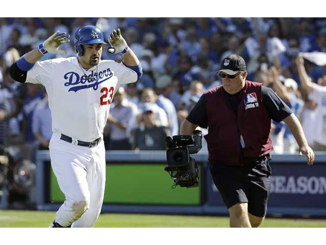 Los Angeles Dodgers first baseman Adrian Gonzalez celebrates after hitting a home run against the St. Louis Cardinals on Wednesday in Los Angeles.