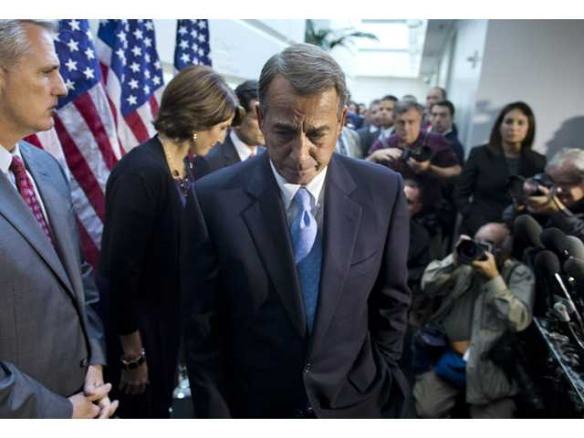 House Speaker John Boehner, R-Ohio, walks away from the microphone during a news conference after a House GOP meeting on Capitol Hill on Tuesday in Washington.