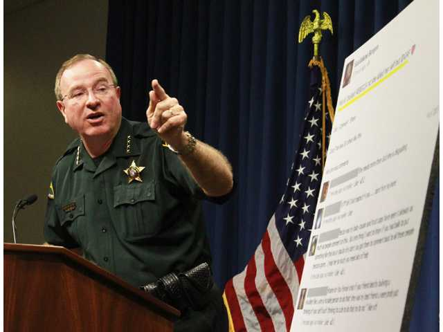 Polk County Sheriff Grady Judd talks about the events leading up to the arrest over the weekend of two juvenile girls in a Florida bullying case at a press conference in Winter Haven, Fla., Monday.