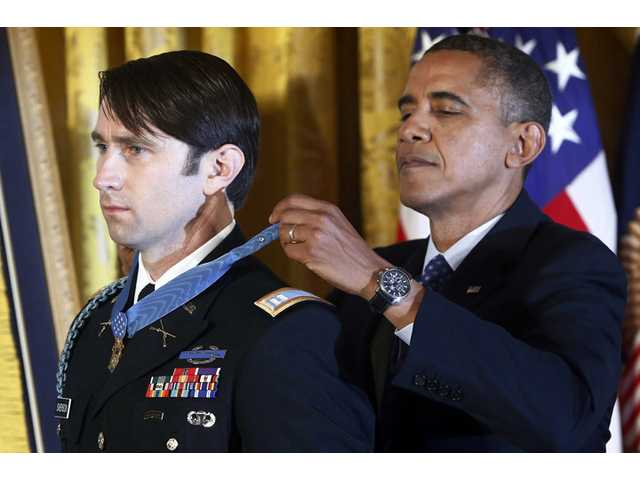 President Barack Obama awards the Medal of Honor to former Army Capt. William D. Swenson of Seattle, Wash., during a ceremony in the East Room at the White House in Washington, Tuesday.