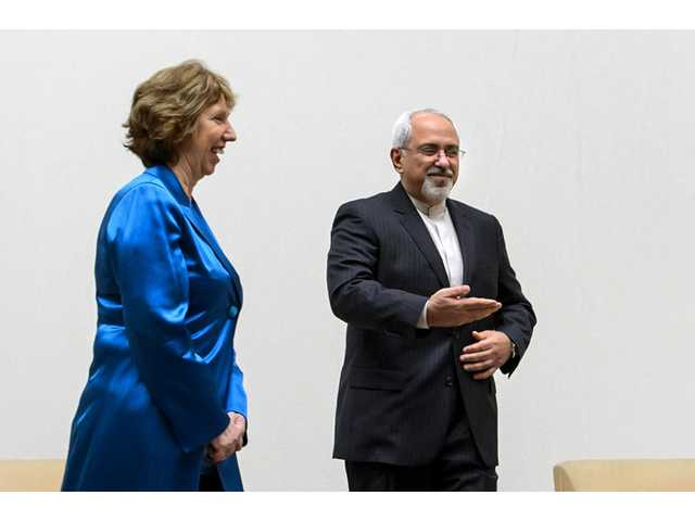 EU High Representative for Foreign Affairs Catherine Ashton, left, walks next to Iranian Foreign Minister Mohammad Javad Zarif during a photo opportunity prior to the start of two days of closed-door nuclear talks Tuesday at the United Nations offices in Geneva.
