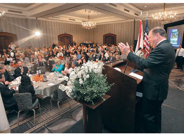 City of Santa Clarita Mayor Bob Kellar introduces his fellow council members at the State of the City Luncheon held in the the Hyatt Regency Valencia grand ball room on Wednesday. Photo by Dan Watson.