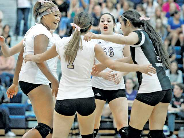 From left, Valencia players Savi Carroll (21), Makena Lautner (7), Hayley Alvarez (66), and Emily Bible (9) celebrate after Valencia made a point against West Ranch at West Ranch High on Wednesday.