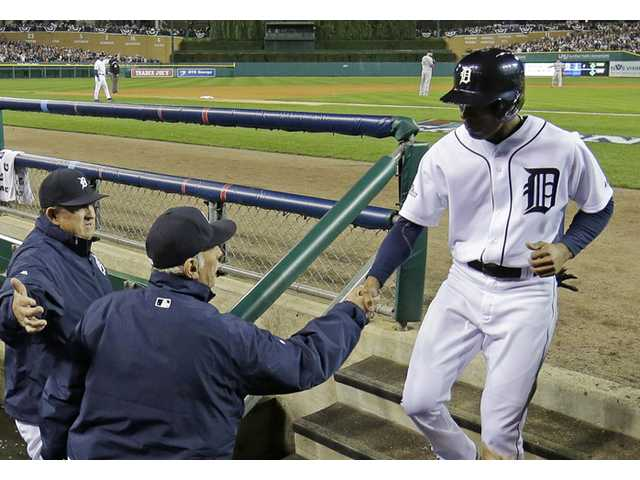 Detroit Tiger Austin Jackson is congratulated by manager Jim Leyland after scoring during Game 4 of the American League championship series against the Boston Red Sox on Wednesday in Detroit.