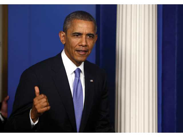 President Barack Obama walks out to make a statement to reporters at the White House in Washington on Wednesday night.