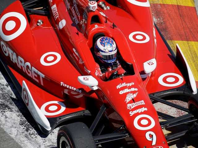 Scott Dixon, of New Zealand, drives through turn three during the second IndyCar Grand Prix of Houston auto race, Sunday, Oct. 6, 2013, in Houston.