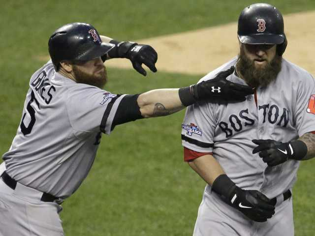 Boston Red Sox's Mike Napoli, right, is greeted by Jonny Gomes following a home run by Napoli in the second inning during Game 5 of the American League baseball championship series against the Detroit Tigers, Thursday, Oct. 17, 2013, in Detroit.