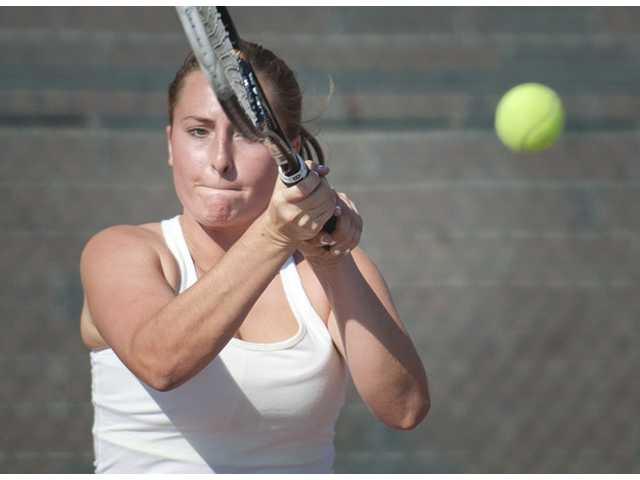 Valencia's Tina Inchalik hits a forehand shot against Canyon's Katrina De Guzman at Canyon High on Thursday.
