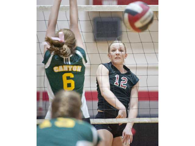 Hart's Corrine Holloway hits the ball past Canyon's Kelli Schmidt at Canyon High on Thursday.