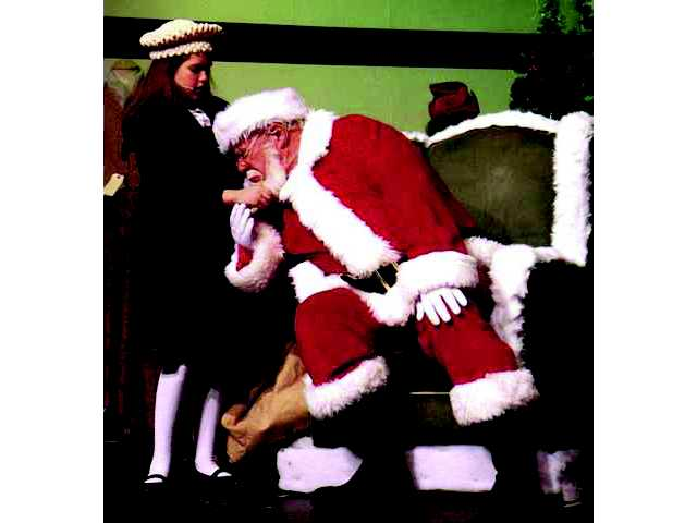 Justine Kelly, as Susan Walker, takes a tug on the beard of Santa, played by Michael Davies in Miracle on 34th Street at the Canyon Theater Guild in December 2009. Signal archive photo