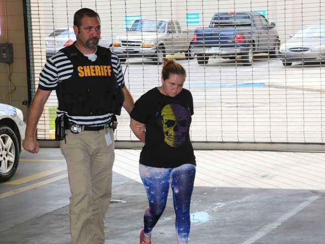 Vivian Vosburg, stepmother of a 14-year-old accused of bullying a Florida girl prior to her suicide, is arrested on unrelated charges of child abuse.