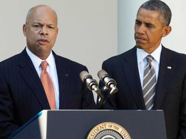 President Barack Obama stands with Jeh Johnson, his choice for the next Homeland Security Secretary, in the Rose Garden at the White House in Washington, Friday, Oct. 18, 2013. Johnson was general counsel at the Defense Department during the wars in Iraq and Afghanistan.