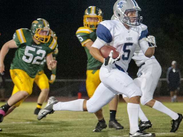 Saugus wide receiver Marc Langford (5) returns a kickoff during Friday's game at Canyon High School.