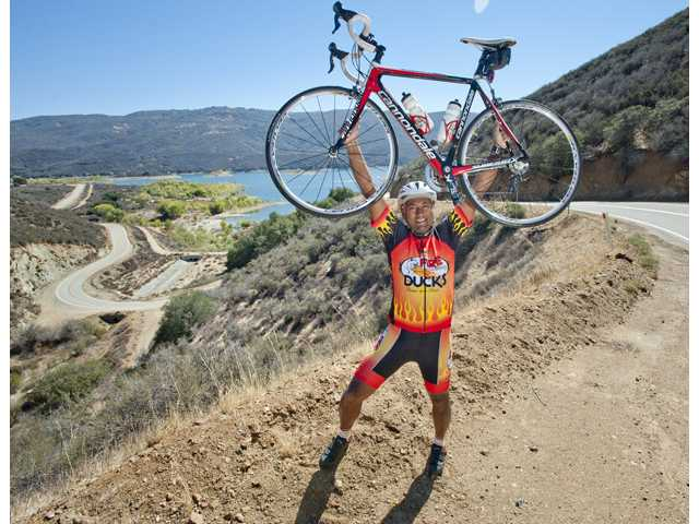 Saugus resident Nabeel Atique poses at Spunky Canyon Road, a 40-mile loop he practices, on Oct. 16. Photo by Charlie Kaijo.