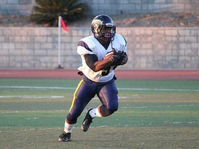 COC's Matt Bowen runs the ball for the Cougars on Saturday in Ventura.