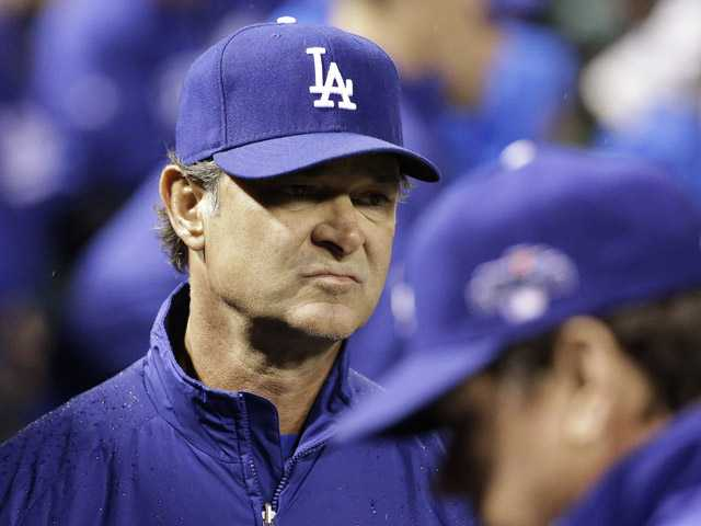 Los Angeles Dodgers manager Don Mattingly looks around the dugout during the eighth inning of Game 6 of the National League baseball championship series against the St. Louis Cardinals, Friday, Oct. 18, 2013, in St. Louis.