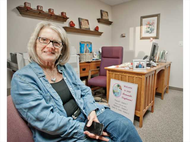 Breast cancer survivor Wendy Thrush, who is also a Circle of Hope board member, sits in the nonprofit's office in Newhall. Photo by Charlie Kaijo.