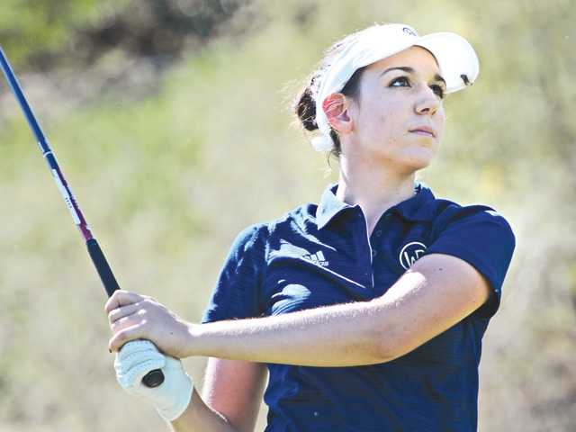 West Ranch's Ashley Mayhall tees off on the second hole at TPC Valencia at the fifth Foothill League match of the season on Tuesday.