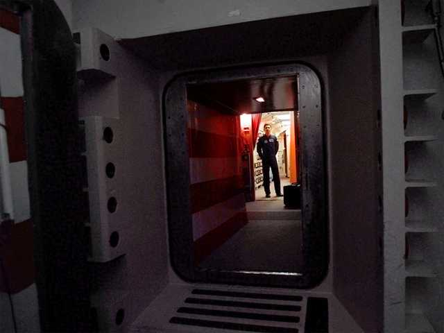 This April 1997 file photo shows an Air Force missile crew commander standing at the door of his launch capsule 100-feet underground  in north-central Colorado.