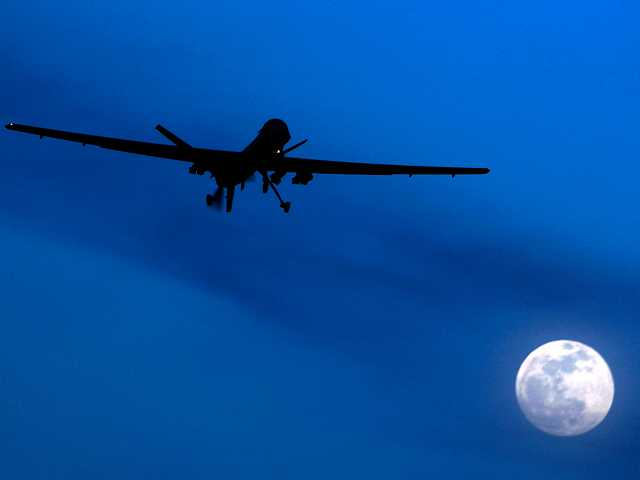 In this Jan. 2010 file photo, an unmanned U.S. Predator drone flies over Kandahar Air Field, southern Afghanistan, on a moon-lit night. A U.N. expert on Friday, Oct. 18, 2013 called on the United States to reveal the number of civilians it believes have been killed by American drone strikes targeting Islamic militants.
