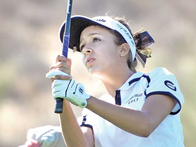 Elisa Pierre of Golden Valley chips onto the first green at TPC on Wednesday. Pierre captured the league MVP award.