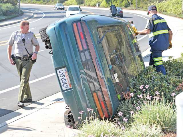 1 injured as car rolls on side on Decoro