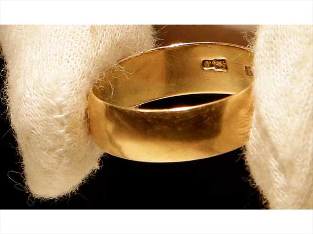 "In this Tuesday photo, Lee Harvey Oswald's wedding ring, which he left at his wife's, Marina Oswald, bedside the morning of the assassination of President John Fitzgerald Kennedy, is part of a themed JFK memorabilia auction ""Camelot: Fifty Years After Dallas"" at the Omni Parker House hotel in Boston. Engraved on the inside of the ring is a Star of Russia."