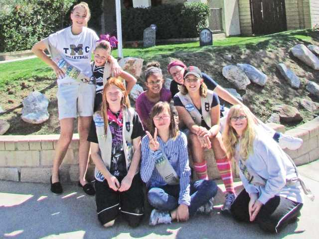 Pictured in photo: Girl Scout Troop 7392: Jaclyn Bogdan, Ayla Wright, Racquel Polanco, Leader Cari Wright, Allison Hall, Jacie Wright, Gina Forbes and Kimmee Posner.