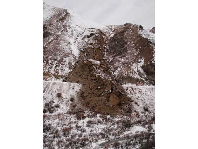 This Oct, 24, 2013 photo, released by the National Park Service shows a large landslide in Denali National Park that has covered parts of a road already inaccessible near Sable Pass, Alaska.