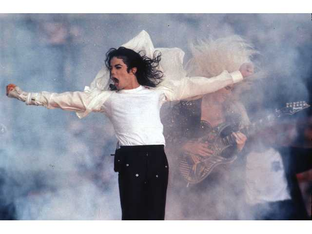 This Feb. 1, 1993 file photo shows Michael Jackson performing during the halftime show at the Super Bowl. Quincy Jones sued Jackson's estate on Friday, claiming that he was owed millions in royalties and fees on music that's been used in post-death Jackson projects.