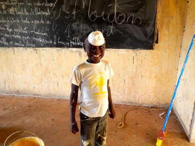 Abdou helping with the task of painting. Courtesy photo.