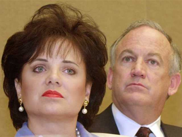In this May 24, 2000 file photo, Patsy Ramsey and her husband, John, parents of JonBenet Ramsey, look on during a news conference in Atlanta regarding their lie-detector examinations for the murder of their daughter.
