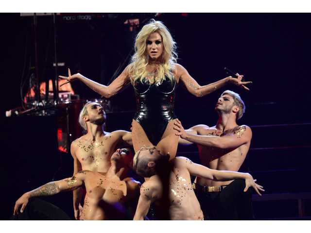 In this Sep. 22 2013 file photo, Ke$ha performs at the IHeartRadio Music Festival, in Las Vegas. Authorities in Malaysia have banned a planned concert after deciding it would hurt cultural and religious sensitivities.
