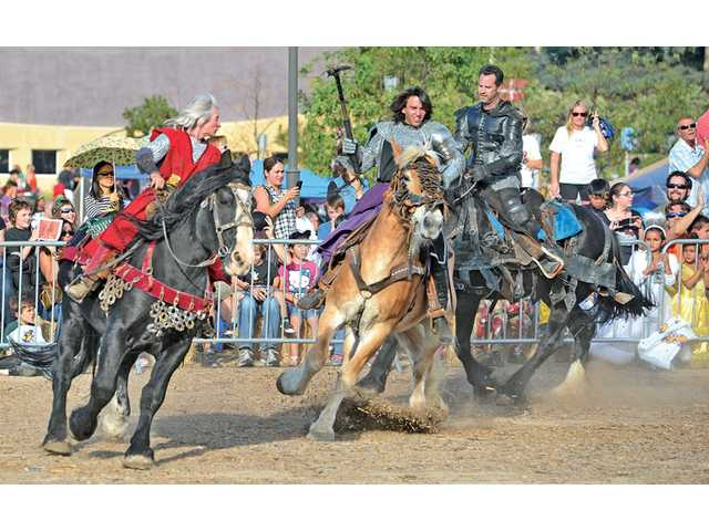 Members of the American Jousting Alliance give a demonstration on horseback as dozens look on at the Halloween at the Castle event presented by Real Life Church in Valencia on Saturday.