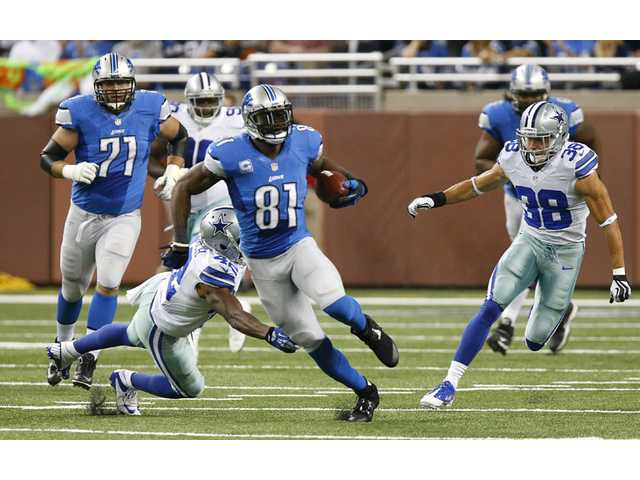 Detroit Lions wide receiver Calvin Johnson (81) breaks free against the against the Dallas Cowboys in Detroit on Sunday.