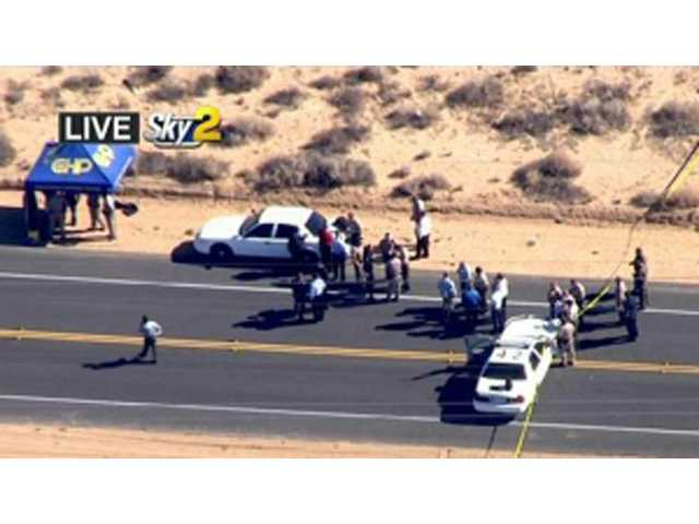 This video image provided by KCBS-TV shows the site of s shooting Friday in Ridgecrest.