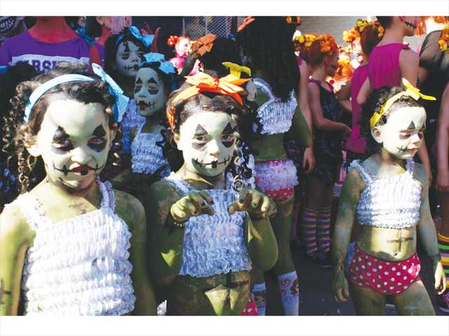Young dancers in spooky makeup prepare to show off their moves at the Haunted Jailhouse at the SCV Sheriff's Station on Sunday. Photo by Jim Holt.
