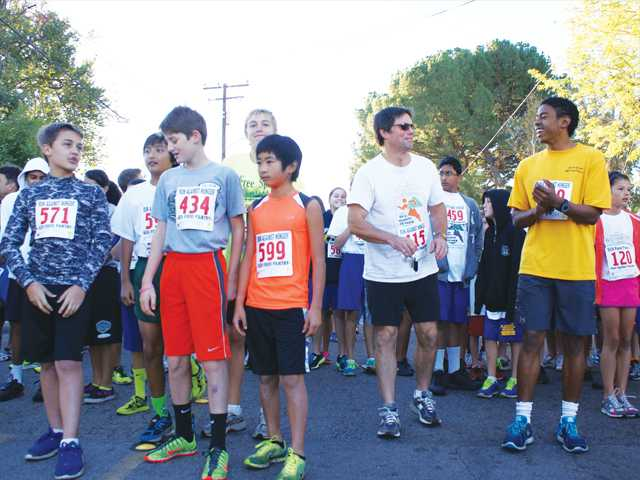 Runners young and old gather at the starting line of Sunday's Run Against Hunger 5K Run/Walk in Newhall. Proceeds of the fundraiser went to the Santa Clarita Valley Food Pantry. Photo by Jim Holt.