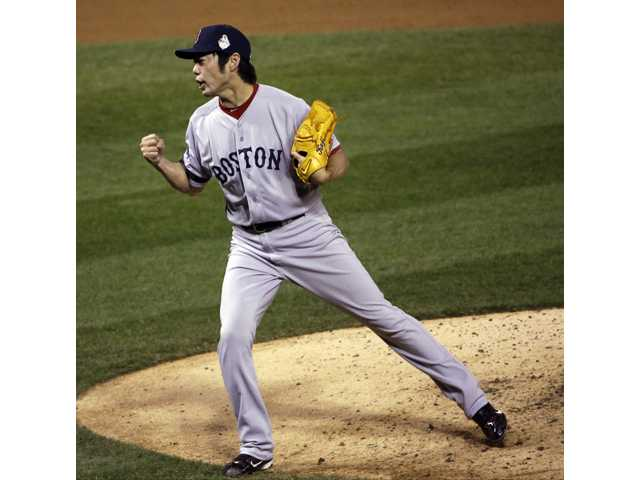 Boston Red Sox relief pitcher Koji Uehara reacts during Game 5 of the World Series on Monday in St. Louis.