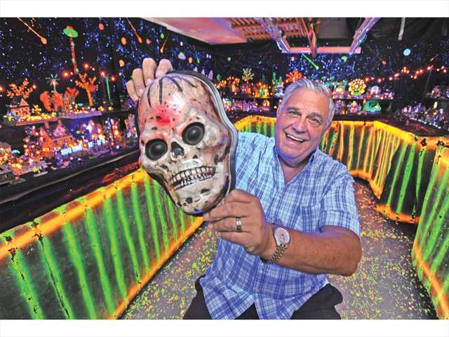 Bob Baida displays his glowing Lemax Halloween miniature villages and figurines in the garage of his home in Canyon Country. Photo by Dan Watson.