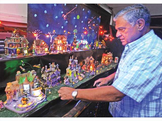 Bob Baida displays his glowing Lemax Halloween miniature villages in his garage at his home in Canyon Country.Photo by Dan Watson.