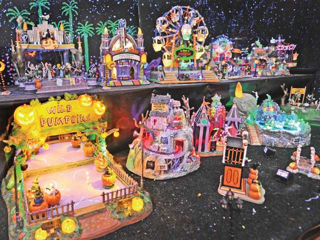 A display of glowing amusement park Halloween miniatures in on display in Bob Baida's garage at his home in Canyon Country. Photo by Dan Watson.